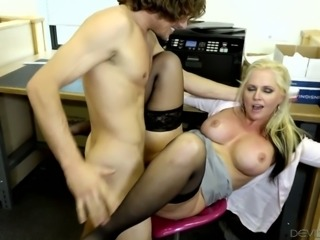 Hot and busty blonde milf is eager to seduce a handsome young man at work