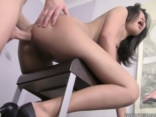 Asian beauty enjoys merciless ass-pounding from behind