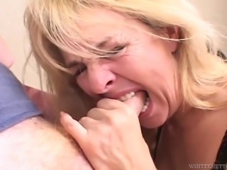 Blonde granny deepthroats a cock before taking it in her snatch