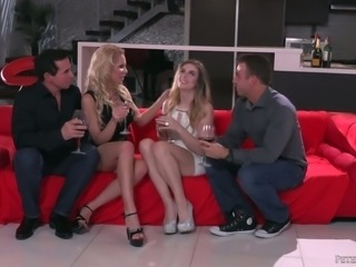 Fabulous and playful blonde cuties on the couch share two men for orgy