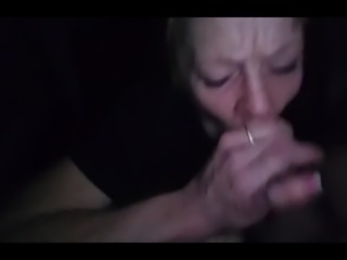 Mature hooker giving gumjob
