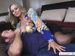 Gorgeous blonde milf babe on the bed seduces a man for passionate sex