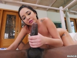 Fabulous brunette white chick with hairy pussy blows black dick on the bed