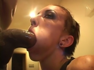 Parish tries to fit a black monster cock in her mouth