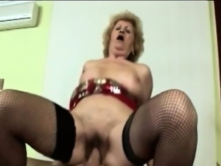 Gorgeous gilf shakes her hips while riding a fat cock