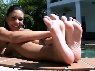 Lustful blond performs a footjob right inside the car