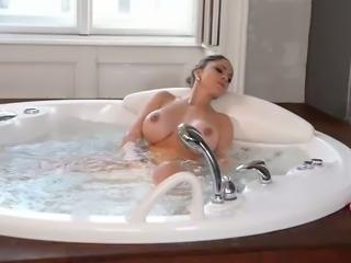 Full bosomed brunette beauty takes bath and toy fucks her kitty greedily