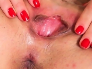 Sweet cutie is gaping tight cunt in close range and having o