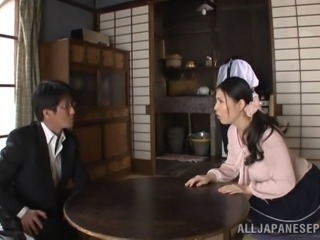 An obedient Japanese girl services her man at the table