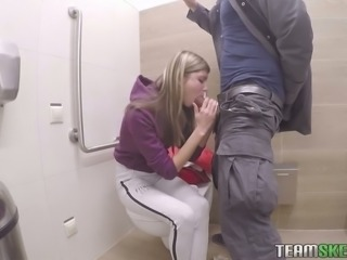 Cute Russian teen in the restroom puts cock in her mouth