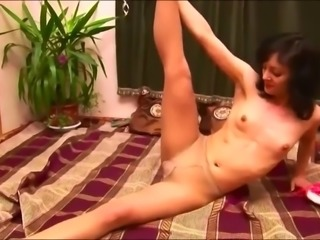 Girl strech in tan pantyhose at home