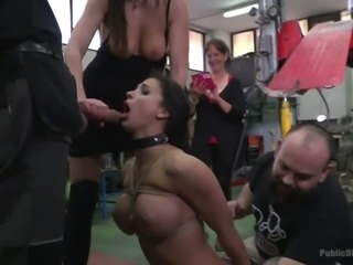 A bit of bondage and mouthfuck with a nice busty brunette in the car station