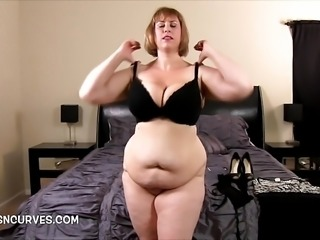 Busty Mom gets herself ready for her stepson