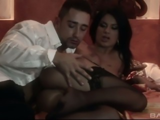 Alluring sexy black haired MILF in black stuff rides and blows fat cock