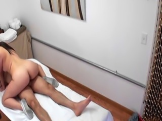Asian masseuse tugging dick while in shoes