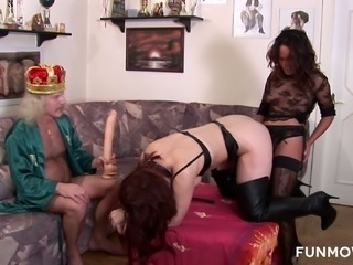 Brunette uses strapon to bang curvy chick doggy while she gives head