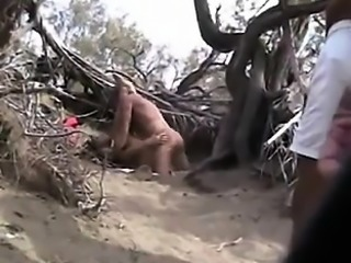 Couple of babes caught by hidden cam on nude beache