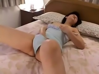 Japanese widow mother in need of sex masturbates