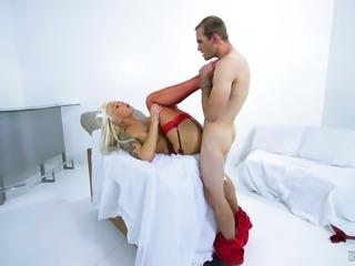 Naughty transsexual nurse Aubrey Kate spreds her legs for a boner