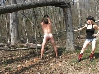 Country girl mistress whipping her slave out in the forest