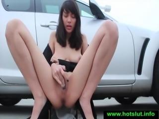 Beautiful brunette masturbates in a car park