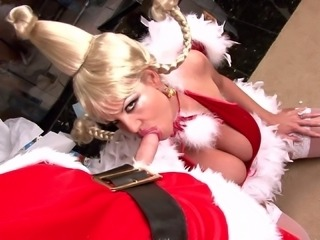 Kelly Madison fucked by a Grinch in front of a Christmast tree