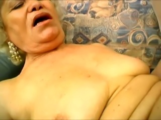 Horny mature slut is thrusting her big toy into this old whore's pussy