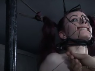 This chick is perfectly obedient with nose hooks keeping her head immobilized