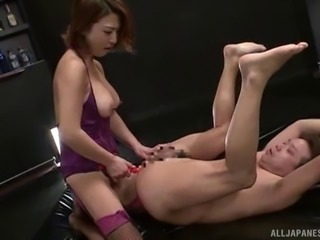 Kinky Japanese girl uses a strapon to peg her man in the butt