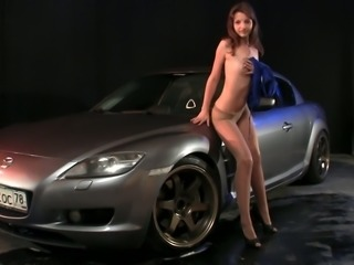 Captivating leggy girl Liona is posing by the luxury car