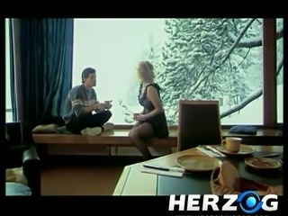 Buxom skier Marilyn Wild gets her a bit hairy pussy fucked missionary