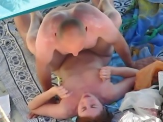 Really love the way he fucks his wife on the beach
