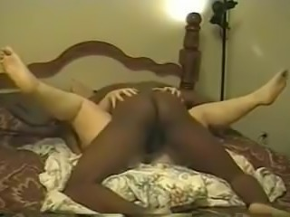 Interracial amateur couple fucking on the bed