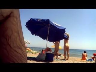 Nudist beach voyeur shoots a sexy mature lady with big boobs