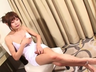 Petite tranny from Asia spreads her legs and masturbates the cock