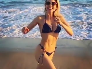Milf Louise running on beach in slowmo showing her great ass