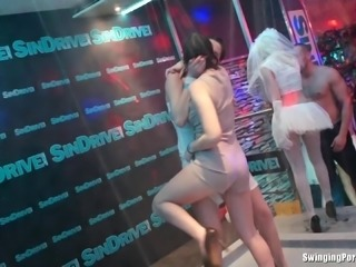 Crazy party girls getting wet while dancing on stage in a shower