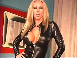 Perfect pornstar modeling a black leather catsuit