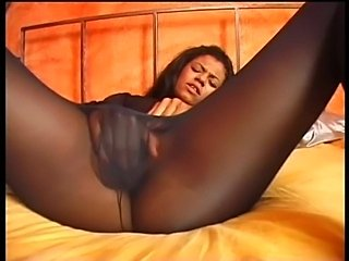 Black ebony whore gives handjob to feel cum on her feet.