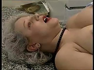 Horny granny is fisted and pissed in the mouth