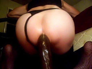 Crossdresser takes huge dildo into ass