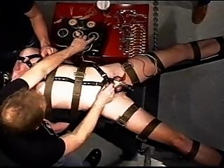 Extreme electro, balls tied tight, suspended in chain and restrained in...