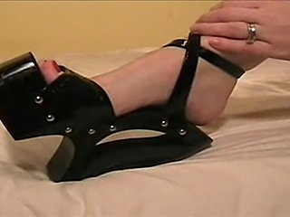 Girl gives fj and bj into shoe, licks up cum and plays with it.
