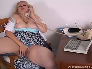 Beautiful big busty amateur MILF loves to talk dirty onthe phone while...