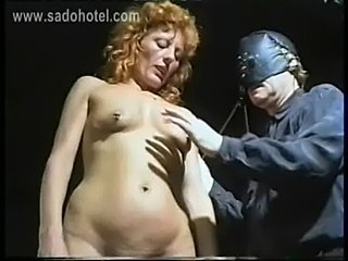 German master removes needles from slave her body and uses a free