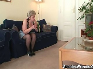 Nasty granny is warming up her cunt before taking intwo cocks