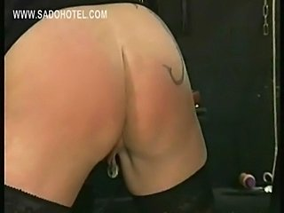 Masked dominitrax spanks one slave on her ass and squeezes cock of other...
