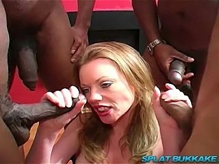 Sexy UK pornstar babe Holly Kiss gets gangbanged by abunch of big black cocks