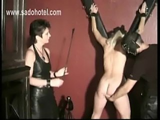 Blond hot slave gets tied to a wall and is spanked on her as free