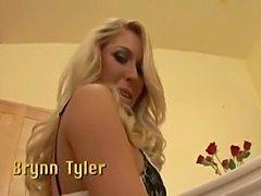 A beautiful blonde has fun while wearing a garter belt